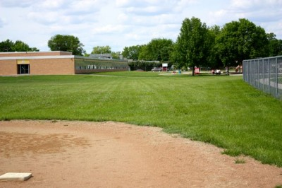 Paynesville Middle School playground. The equipment has been updated over the years, but the side door (on left) is still in the same place.